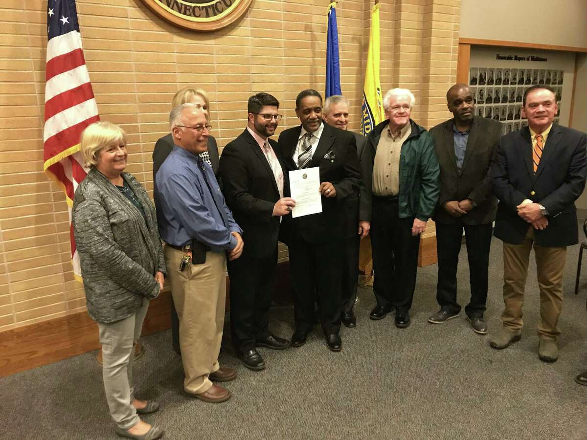 Common Council members and Mayor Dan Drew celebrate Bishop W. Vance Cotten's swearing in to the council on Monday night.