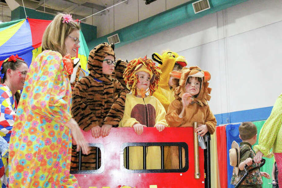 Four- and five-year-old students perform in the 54th annual YMCA Preschool Circus April 5. The preschoolers perform dressed as a circus character of their choosing while the teachers and parents dressed as clowns. Photo: Submitted For The Intelligencer