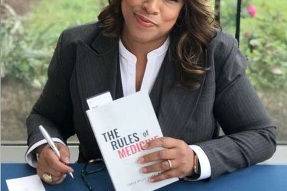 "Dr. Sonya Sloan at the signing of her book, ""The Rules of Medicine,"" on March 31 at The African American Library at the Gregory School in Houston."