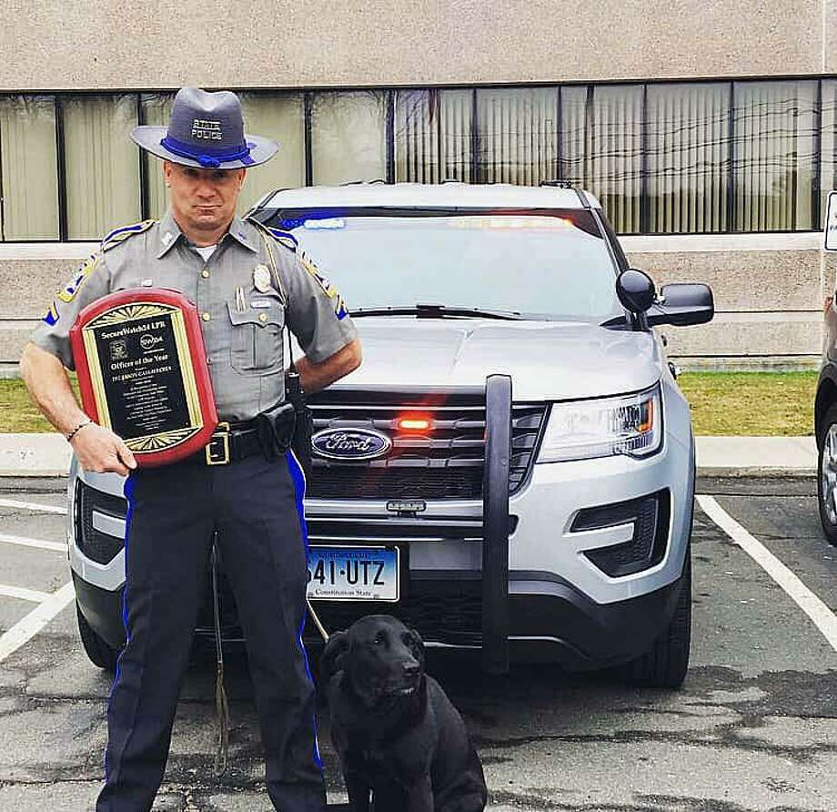 In a ceremony Tuesday morning, Trooper First Class Jason Cassavechia was named the 2018 Office of the Year recipient by SecureWatch24. Photo: Contributed Photo / Connecticut State Police / Contributed Photo / Connecticut Post Contributed