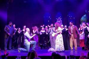 """Broadway's Marissa Follo Perry receives a surprise proposal onstage Sunday near the close of the final performance of """"Sister Act,"""" at the Downtown Cabaret Theatre in Bridgeport."""