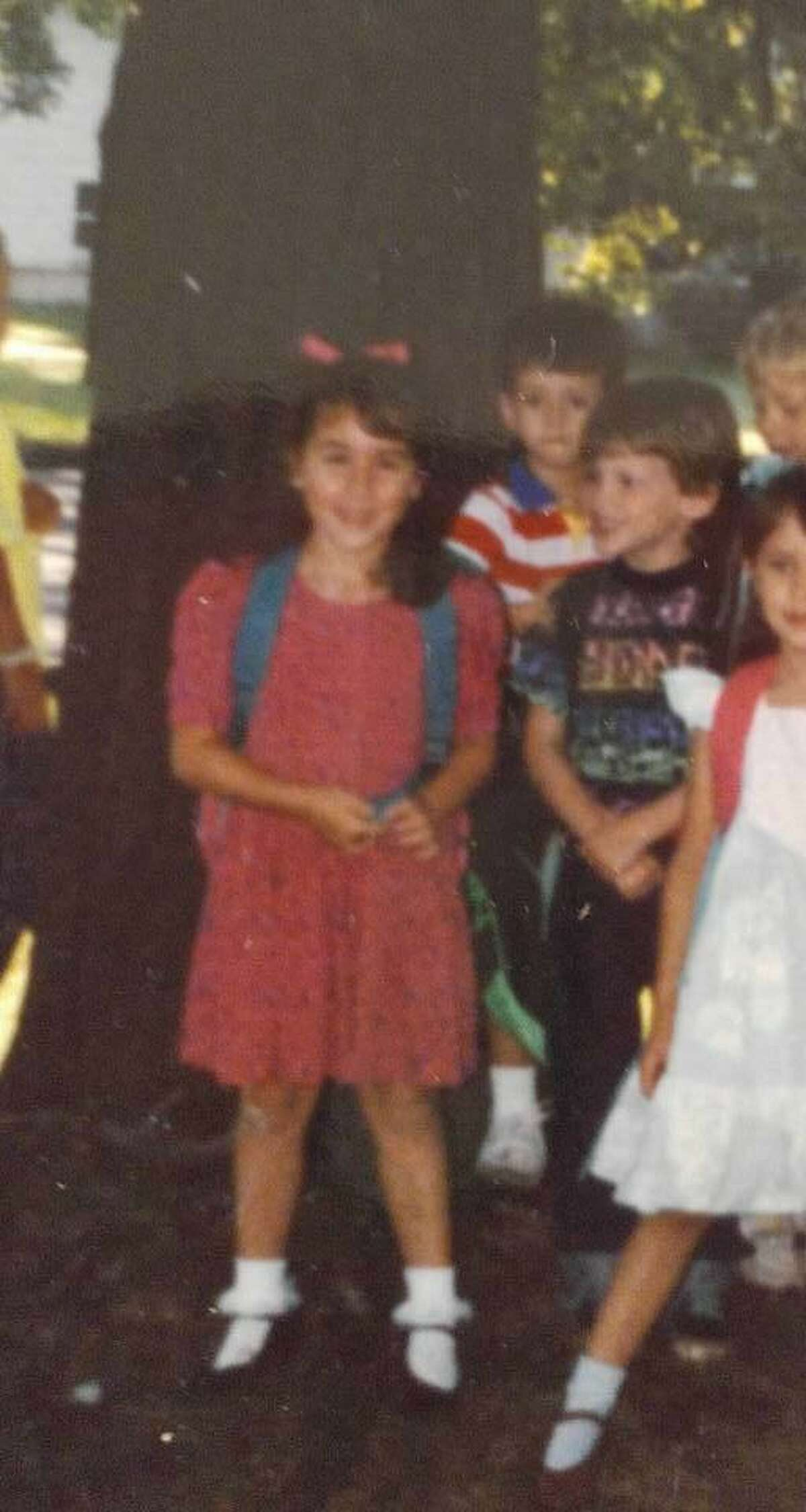 Broadway's Marissa Follo Perry and her fiancé, Chris Jones, are seen here on their first day of kindergarten. Jones, staring at her, says he was smitten from the moment they met.
