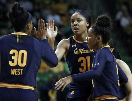 California's CJ West (30), Kristine Anigwe (31) and Kianna Smith, right, celebrate a basket by Anigwe in the first half of a second-round game in the NCAA women's college basketball tournament in Waco, Texas, Monday, March 25, 2019. (AP Photo/Tony Gutierrez)