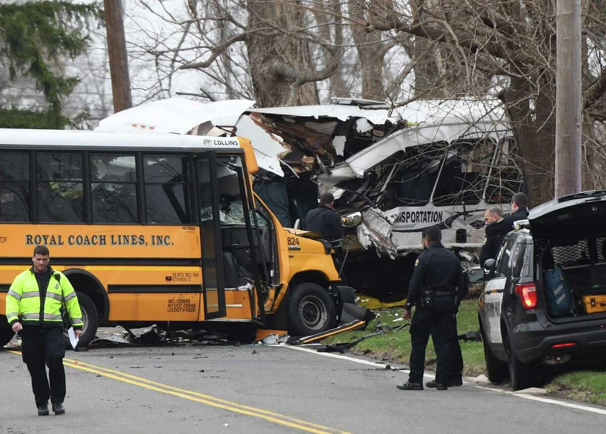 Police, EMS and firefighters respond to a school bus crash on King Street near Brunswick School in Greenwich, Conn. Tuesday, April 9, 2019.