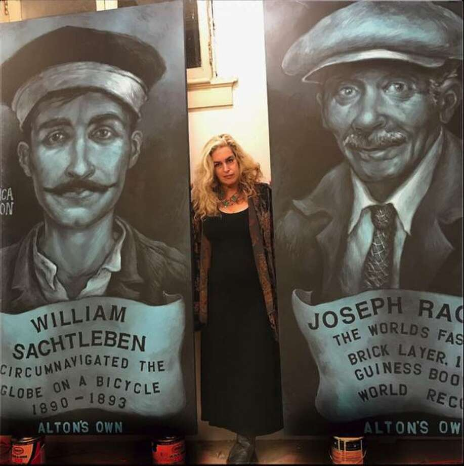 Artist Monica Mason stands between two of her eight-foot portraits of Joseph Raglin and William Sachtleben that she painted for an historic portrait project at the Post Commons.