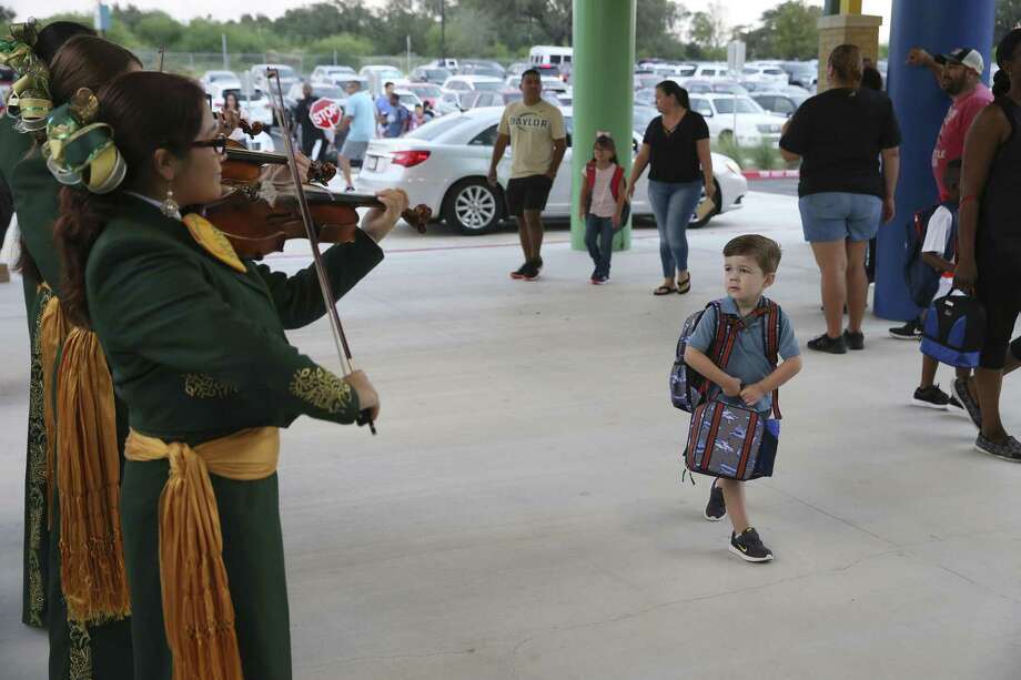 Three-year-old Bradley Miller checks out the Holmes High School Mariachi as he arrives for the first day of classes at the new Dr. Linda Mora Elementary School, Monday, August 27. The Northside Independent School District is well run — why three incumbents for board elections deserve reelection. Photo: JERRY LARA /San Antonio Express-News / © 2018 San Antonio Express-News