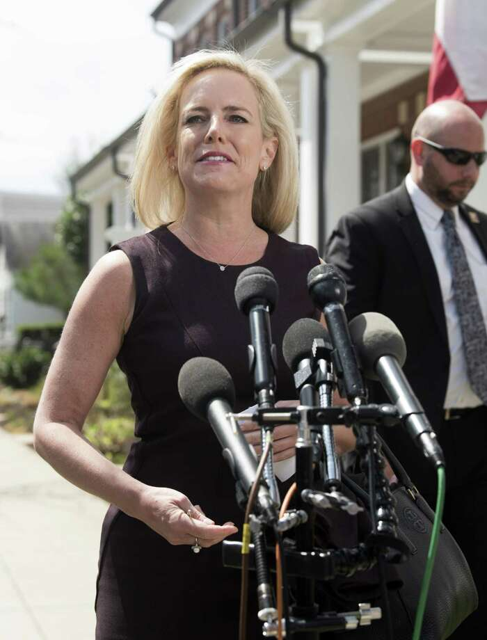 Homeland Security Secretary Kirstjen Nielsen talks outside her home in Alexandria, Va., on Monday. Nielsen enforced President Trump's draconian immigration policies. She was sacked for her troubles. Photo: Kevin Wolf /Associated Press / Copyright 2019 The Associated Press. All rights reserved