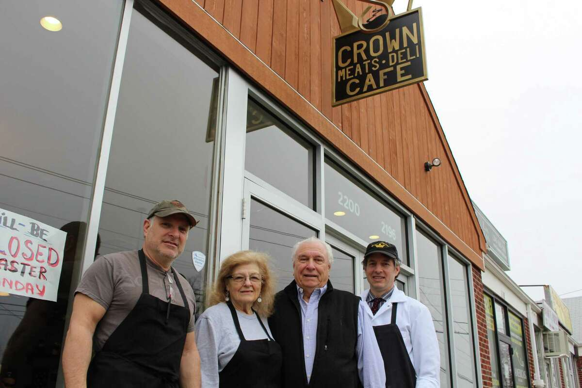 From left, Craig Nichio, Jeanette Nichio, Richard Nichio Sr. and Richard Nichio Jr. After roughly two decdades, the Nichio family is back in business in Bridgeport's North End, transforming the former Crown Budget Market into the Crown Café.