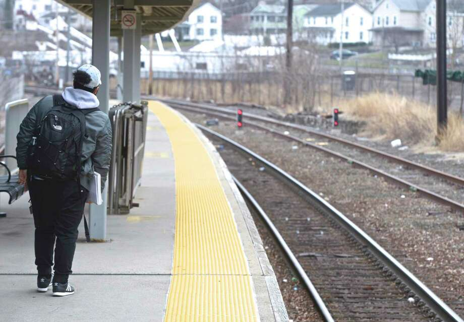 Justin Alam, a student at Western Connecticut State University, waits for a Metro North train at the Danbury train station. Tuesday, April 9, 2019, in Danbury, Conn. Photo: H John Voorhees III / Hearst Connecticut Media / The News-Times