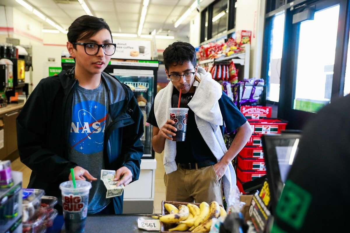 (l-r) Friends Carlos Ramirez, 16 and Josue llamas, 15 buy Big Gulp sodas at 7-11 on Mission Street in San Francisco, California, on Monday, Feb. 18, 2019.