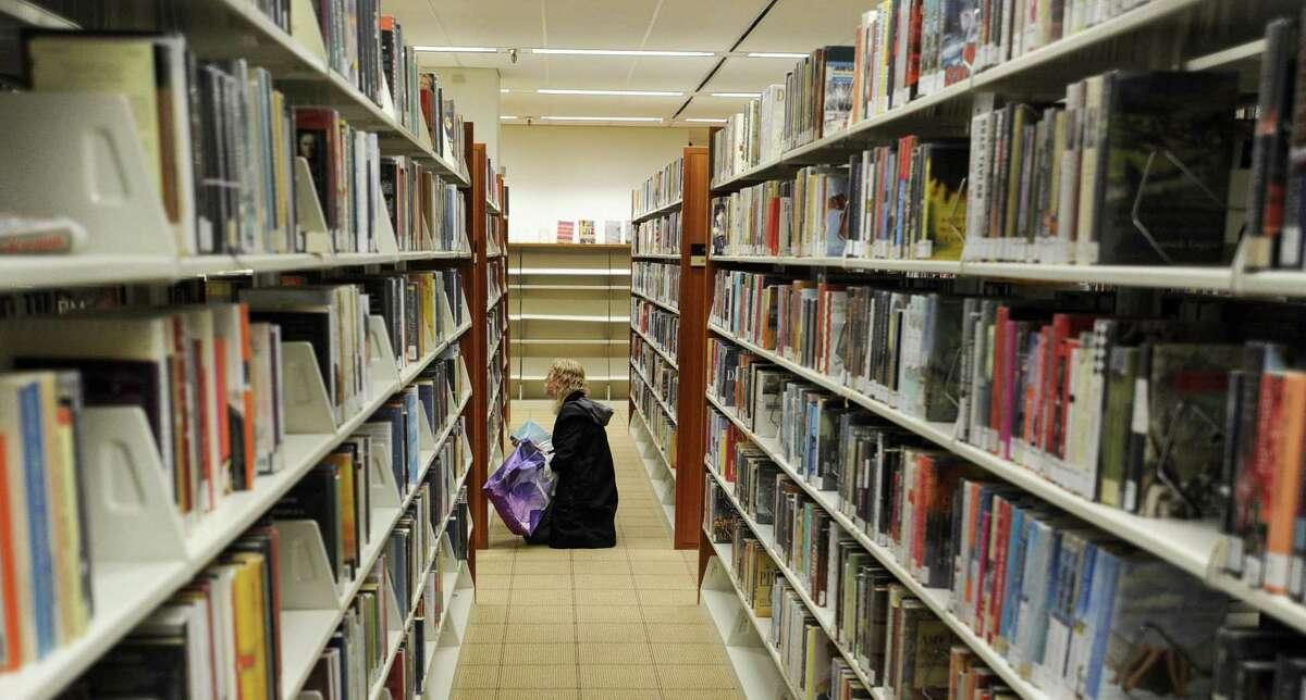 A library patron browses for a book at Ferguson Library in Stamford.