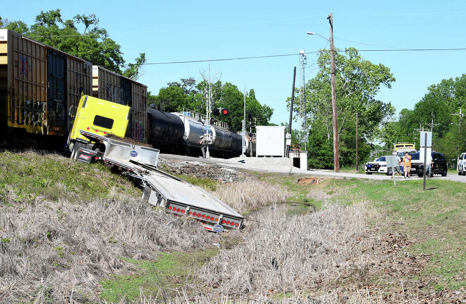 A tractor trailer and a train collided Tuesday at the intersection the Kansas City Southern line and Mockingbird Drive in Rose City. No injuries were reported.  Photo taken Tuesday, 4/9/19 Photo: Guiseppe Barranco/The Enterprise / Guiseppe Barranco ?