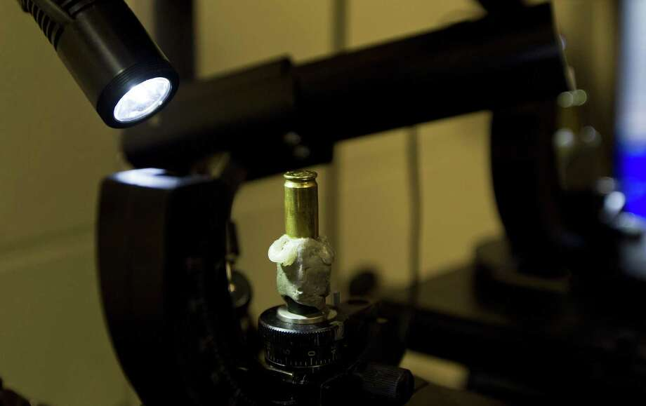 A bullet is stationed under a microscope used to compare evidence at the Montgomery County Sheriff's Office crime lab, Tuesday, April 9, 2019, in Conroe. Photo: Jason Fochtman, Houston Chronicle / Staff Photographer / © 2019 Houston Chronicle