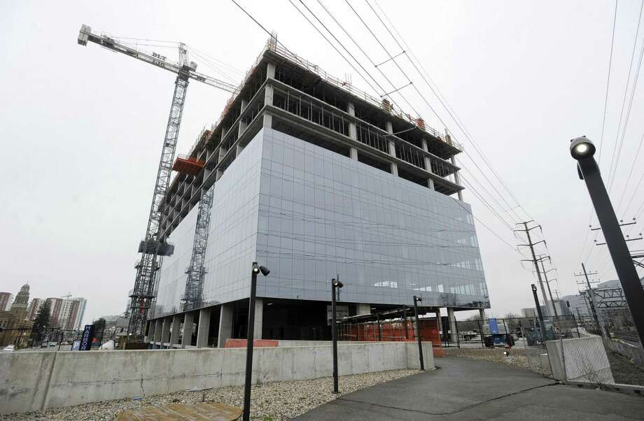 Charter Communications, which will eventually make this 15-story glass tower its headquarters, won the right on April 8, 2019, to expand and build a second, nine-story building connected by a three-story lobby at the Gateway site, just south of Interstate 95 in Stamford's South End. Photo: Matthew Brown / Hearst Connecticut Media / Stamford Advocate