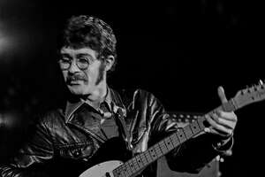 The Band guitarist, Robbie Robertson, performs during one of the group's debut performances in April 1969 at San Francisco's Winterland Ballroom.   Fifty years later, this is the first time these photos are being published.