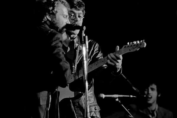 Drummer and mandolin player Levon Helm, left, and guitarist Robbie Robertson during one of The Band's debut performances in April 1969 at San Francisco's Winterland Ballroom. Fifty years later, this is the first time these photos are being published.