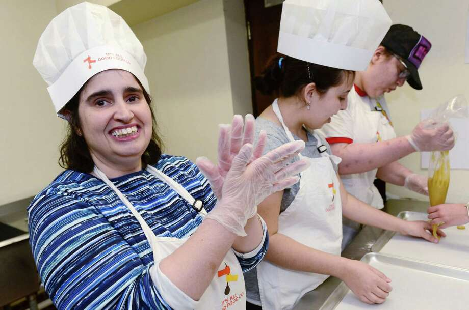 Gina Lopriore, Hillary Lipper, and Hannah Costa make crinkle cookies for Crumb Together Bakery Tuesday, Apriul 9, 2019, in the kitchen at Beth Israel Synagogue in Norwalk, Conn. Crumb Together Bakery was opened last October at Beth Israel Synagogue in Norwalk, as part of the work that the nonprofit Circle of Friends does to teach job skills to adults with disabilities. Photo: Erik Trautmann / Hearst Connecticut Media / Norwalk Hour
