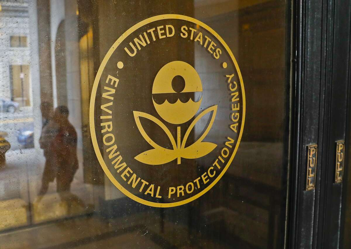 FILE - This Sept. 21, 2017, file photo shows the Environmental Protection Agency building in Washington. Flooding in the Midwest temporarily cut off a Superfund site in Nebraska that stores radioactive waste and explosives, inundated another one storing toxic chemical waste in Missouri, and limited access to others, the EPA said Wednesday, March 27, 2019. (AP Photo/Pablo Martinez Monsivais, File)