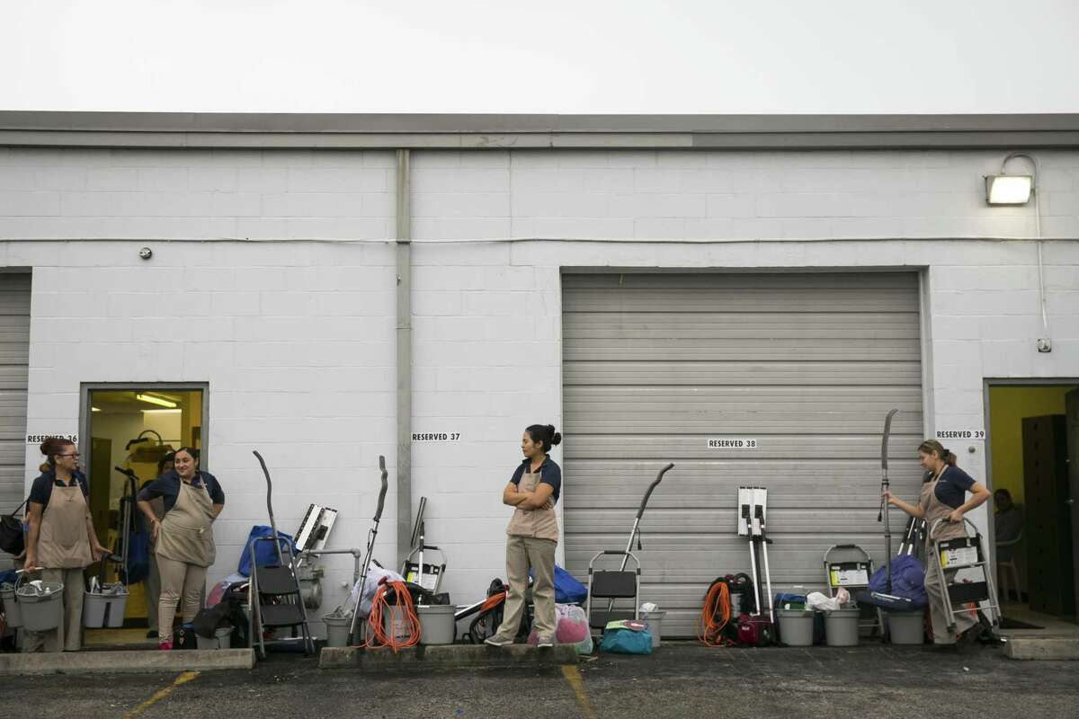 Women gather supplies and wait to load them in cars during morning deployment on Friday, April 5, 2019, at Maid Brigade, a residential cleaning service in Gulfton. Some local businesses, such as Maid Brigade, opposed the rule by the Texas Workfoce Commission, as they worry it would make it more difficult for them to compete with large tech companies like Handy.