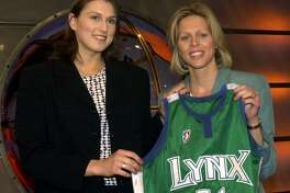 Connecticut's Svetlana Abrosimova was chosen as the number seven pick in the WNBA draft by the Minnesota Lynx Friday, April 20, 2001, in Secaucus, N.J. WNBA President Val Ackerman presents her with the Lynx jersey. (AP Photo/Bill Kostroun)