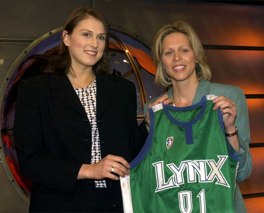 Connecticut's Svetlana Abrosimova was chosen as the number seven pick in the WNBA draft by the Minnesota Lynx Friday, April 20, 2001, in Secaucus, N.J. WNBA President Val Ackerman presents her with the Lynx jersey. (AP Photo/Bill Kostroun) Photo: BILL KOSTROUN / Associated Press / AP