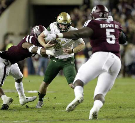 Bobby Brown III (5), going after UAB quarterback Tyler Johnston, played in all 13 games as a freshman for the Aggies and may have found a home in the interior line.