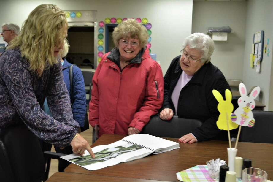 Winsted Senior Center Director Jennifer Kelley, left, looks at the Hinsdale project plan with Beverly Pisani, center and Lois Bascetta at a community meeting on Tuesday. Photo: Leslie Hutchison / Hearst Connecticut Media