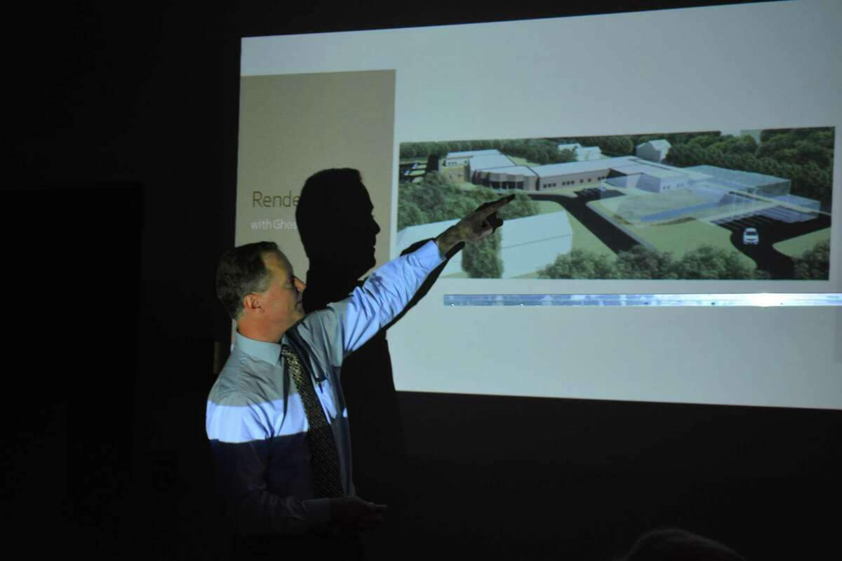 Architect Paul E. Jorgensen, an associate of Silver Petrucilli & Associates Inc., shows how Hinsdale school would appear if it wererenovated.