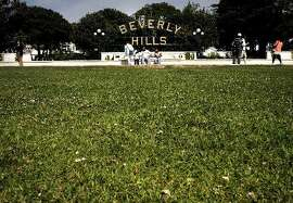 Green lawns at Beverly Gardens Park greet visitors to the Southern California City of Beverly Hills, Calif., as seen on Thurs. April 9, 2015.