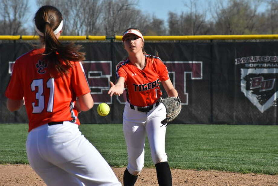 Edwardsville second baseman Jayna Connoyer flips a throw to first for a force out. Photo: Matt Kamp/The Intelligencer