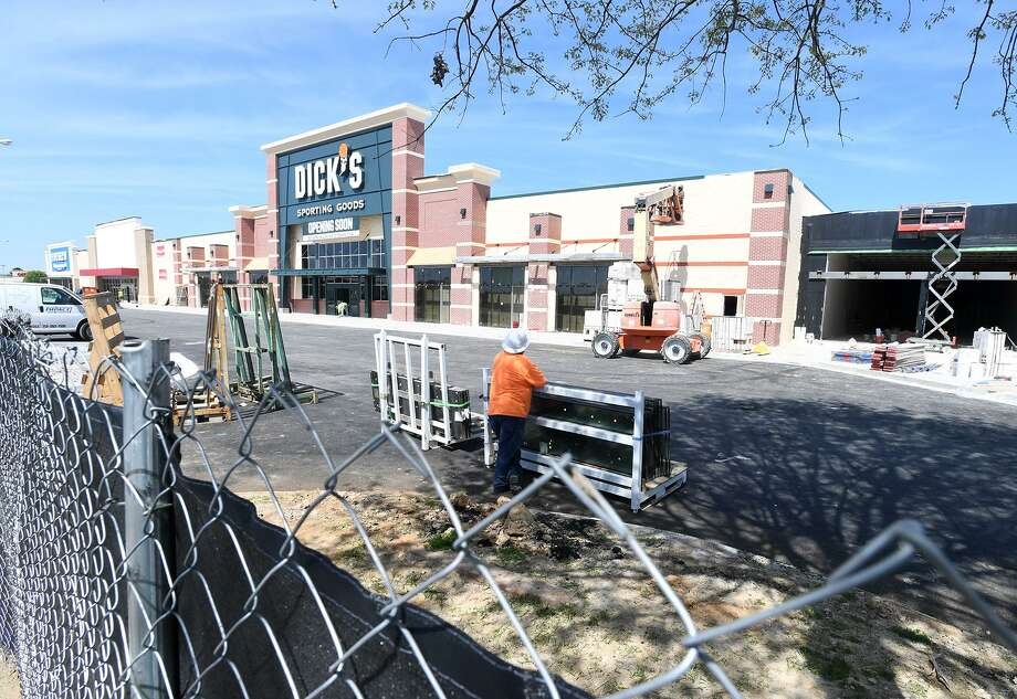 Work continues Friday on the outside of Parkdale Mall where several new stores including Dick's Sporting Goods and Five Below are expected to open soon.  Photo taken Friday, 3/22/19 Photo: Guiseppe Barranco/The Enterprise, Photo Editor / Guiseppe Barranco ©