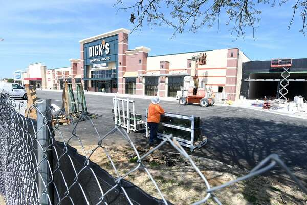 Work continues Friday on the outside of Parkdale Mall where several new stores in eluding Dick's Sporting Goods and Five Below are expected to open soon. Photo taken Friday, 3/22/19