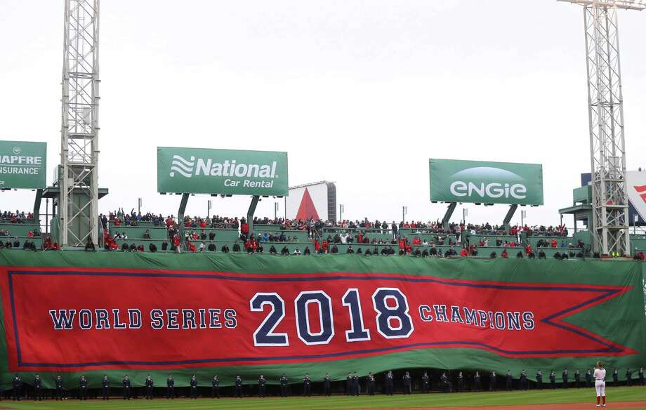 The Boston Red Sox unveil the 2018 World Series Championship banner before the home opener against the Toronto Blue Jays at Fenway Park Tuesday. Photo: Maddie Meyer / Getty Images / 2019 Getty Images
