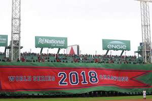 The Boston Red Sox unveil the 2018 World Series Championship banner before the home opener against the Toronto Blue Jays at Fenway Park Tuesday.