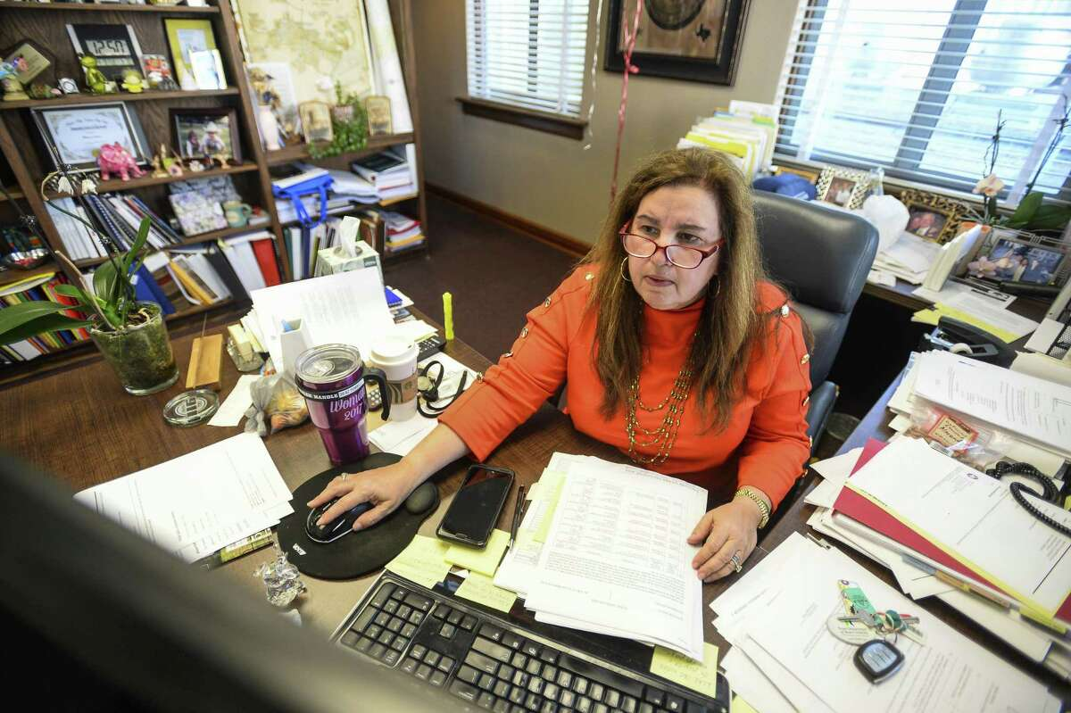 Allison Getz, the tax assessor/collector and voter registrar for Jefferson County, works in her office on Tuesday. Photo taken on Tuesday, 04/09/19. Ryan Welch/The Enterprise
