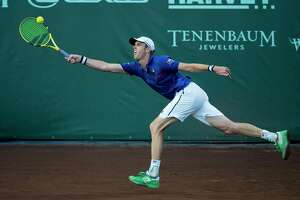 Sam Querrey reaches for a ball hit by Bjorn Fratangelo in a first round match of the Fayez Sarofim & Co. U.S. Men's Clay Court Championship at River Oaks Country Club in Houston, Tuesday, April 9, 2019.