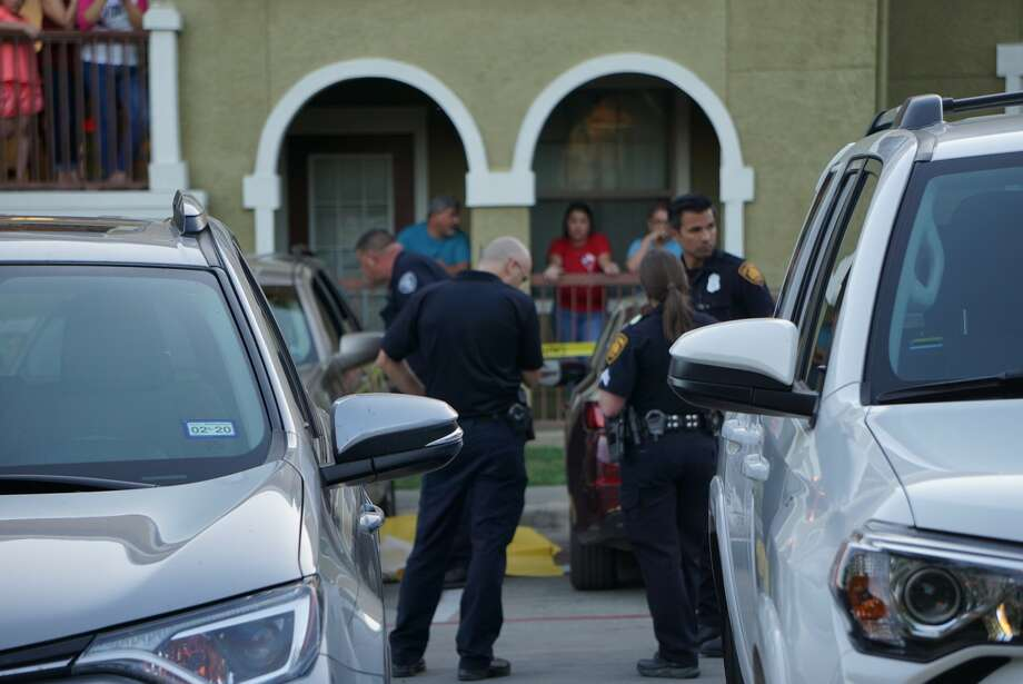 A woman is dead after a shooting at about 7 p.m. Tuesday, April 9, in the parking lot of the Rosemont at University Park apartments, 102 Emerald Ash. Photo: Jacob Beltran For MySA.com