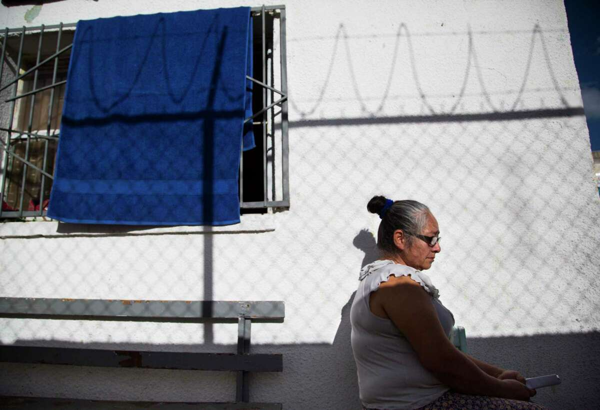 Juana Acosta, 53, a migrant from Honduras, takes shelter in April 2019 in Ciudad Juárez after U.S. immigration authorities placed her grandchildren in federal custody but sent her to Mexico to await her U.S. court date. She was among the first asylum seekers returned to Ciudad Juárez under that Trump administration policy. On Friday, a California federal court blocked the program, though an appeal to the Supreme Court is likely.