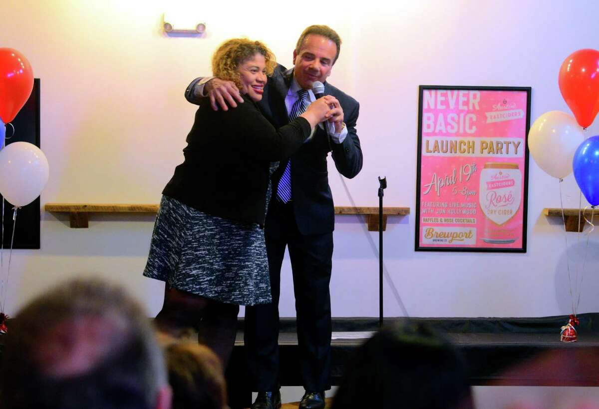 Mayor Joe Ganim hugs Bridgeport City Council President Aidee Nieves after addressing Ganim supporters at a fundraiser for his mayoral campaign at Brewport restaurant in Bridgeport, Conn., on Tuesday April 9, 2019. This is the first fundraiser since last raising money in 2017.