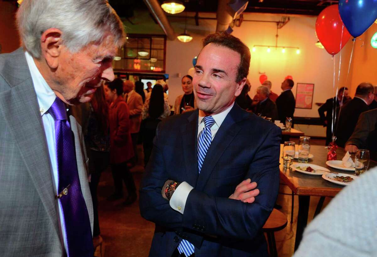 Mayor Joe Ganim chats with Edward Marcus, left, during a fundraiser for his mayoral campaign at Brewport restaurant in Bridgeport, Conn., on Tuesday April 9, 2019. Marcus, who has supported Ganim since the 90's, is a former Democratic State Chairman and former Senate Majority Leader. This is the first fundraiser Ganim has held since last raising money in 2017.