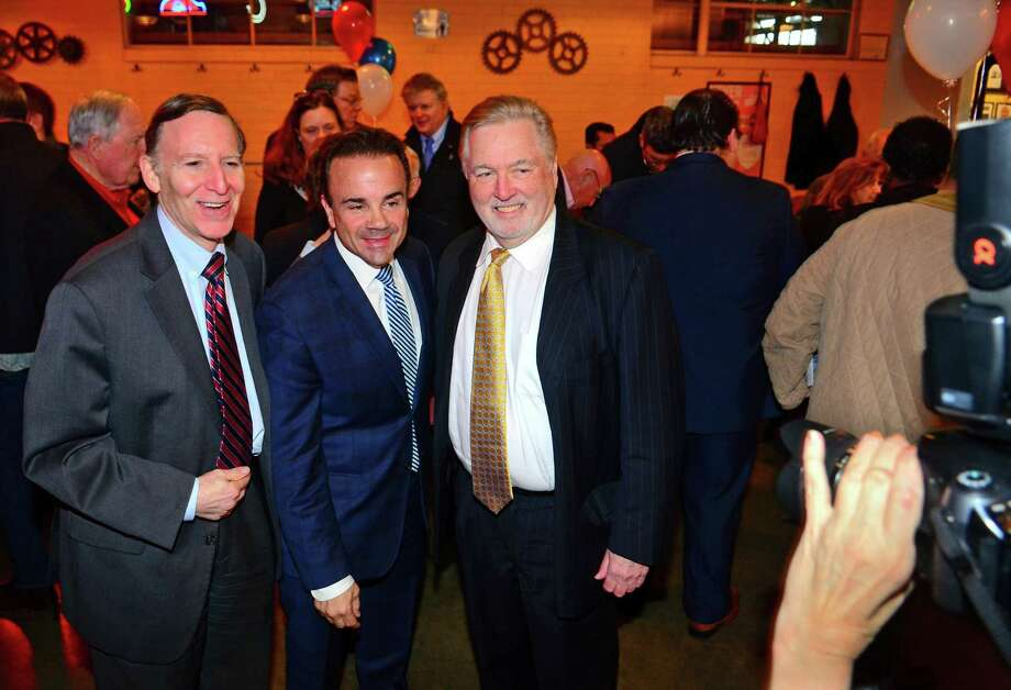Mayor Joe Ganim, center, poses for a photo with Kenneth Flatto, left, and attorney Bob Berchem during the fundraiser  at Brewport restaurant  on Tuesday. April 9, 2019. This is the first fundraiser Ganim has held since last raising money in 2017. Photo: Christian Abraham / Hearst Connecticut Media / Connecticut Post