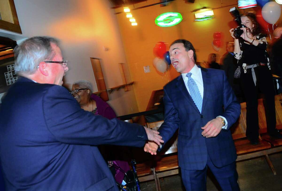 Mayor Joe Ganim, right, reacts as he greets supporter Fred Hall during a fundraiser for his mayoral campaign at Brewport restaurant in Bridgeport, Conn., on Tuesday April 9, 2019. This is the first fundraiser Ganim has held since last raising money in 2017.