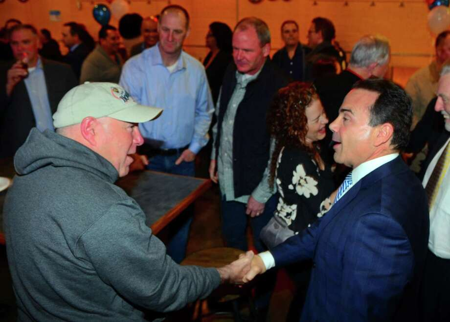 Mayor Joe Ganim, right, greets Bridgeport Police Chief AJ Perez during a fundraiser for Ganim's mayoral campaign at Brewport restaurant in Bridgeport, Conn., on Tuesday April 9, 2019. This is the first fundraiser Ganim has held since last raising money in 2017. Photo: Christian Abraham / Hearst Connecticut Media / Connecticut Post