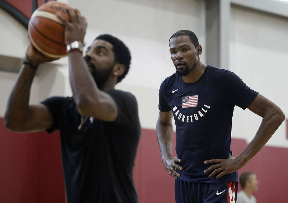 Kevin Durant, right, watches Kyrie Irving during a training camp for USA Basketball, Thursday, July 26, 2018, in Las Vegas. The two are slated to sign with the Brooklyn Nets to 4-year deals work more than a combined $300 million, according to ESPN's Adrian Wojnarowski.  Check out the gallery ahead to see everything Durant has said about his free agency up to this point. >>> Photo: John Locher / AP