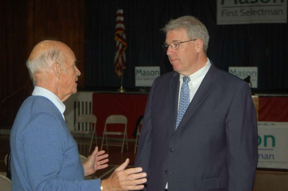 Before he officially kicked off his campaign for first selectman, Michael Mason, at right, got some last minute political advice from former state senator William Nickerson. Photo: Ken Borsuk