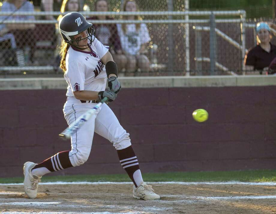 Magnolia catcher Alex Dubose (12) hits a pitch during a District 19-5A softball game Tuesday, April 9, 2019 at Magnolia High School. Photo: Cody Bahn, Houston Chronicle / Staff Photographer / © 2018 Houston Chronicle