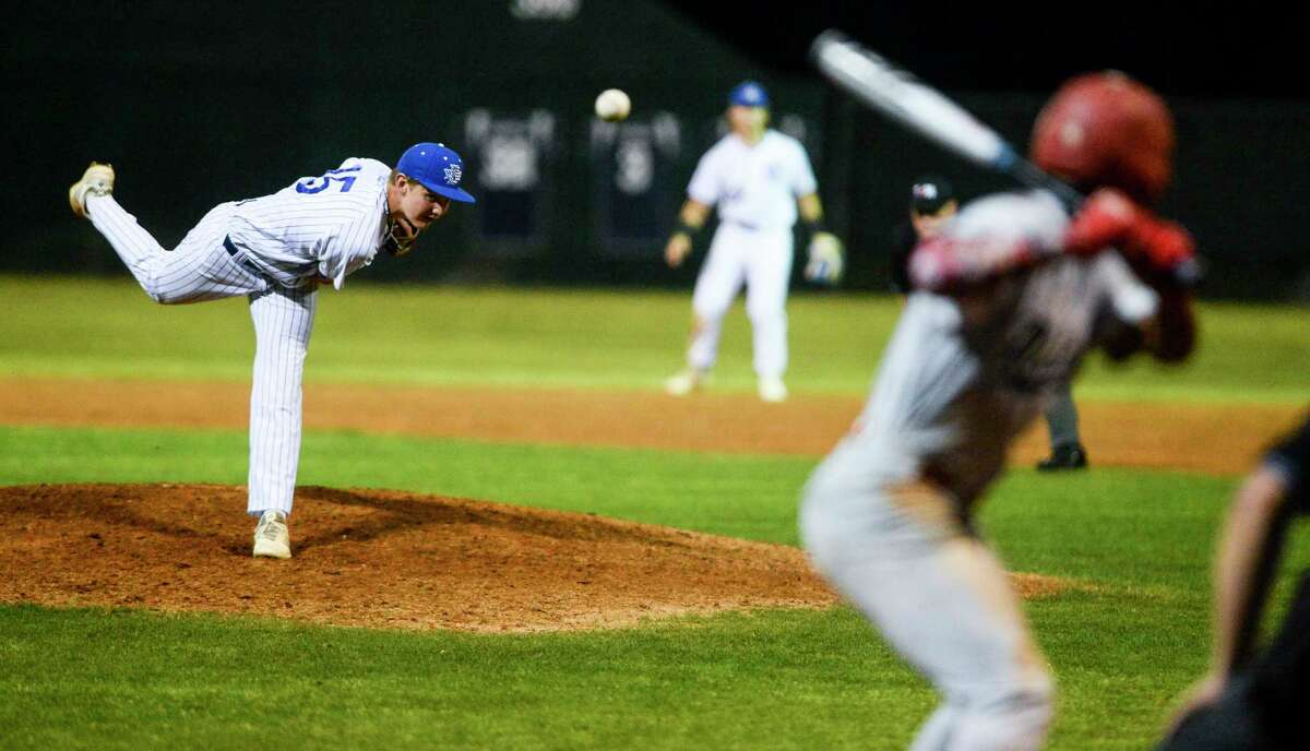 West Brook's Sam Hall pitches during the game against North Shore at West Brook High School Tuesday night. Photo taken on Tuesday, 04/09/19. Ryan Welch/The Enterprise