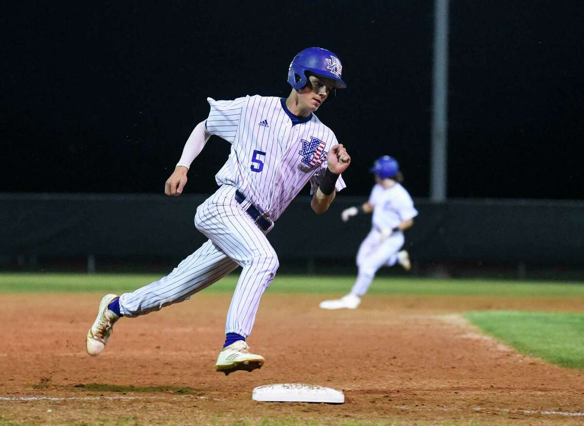 West Brook's Nathan Montabano runs pass third base heading home during the game against North Shore at West Brook High School Tuesday night. Photo taken on Tuesday, 04/09/19. Ryan Welch/The Enterprise