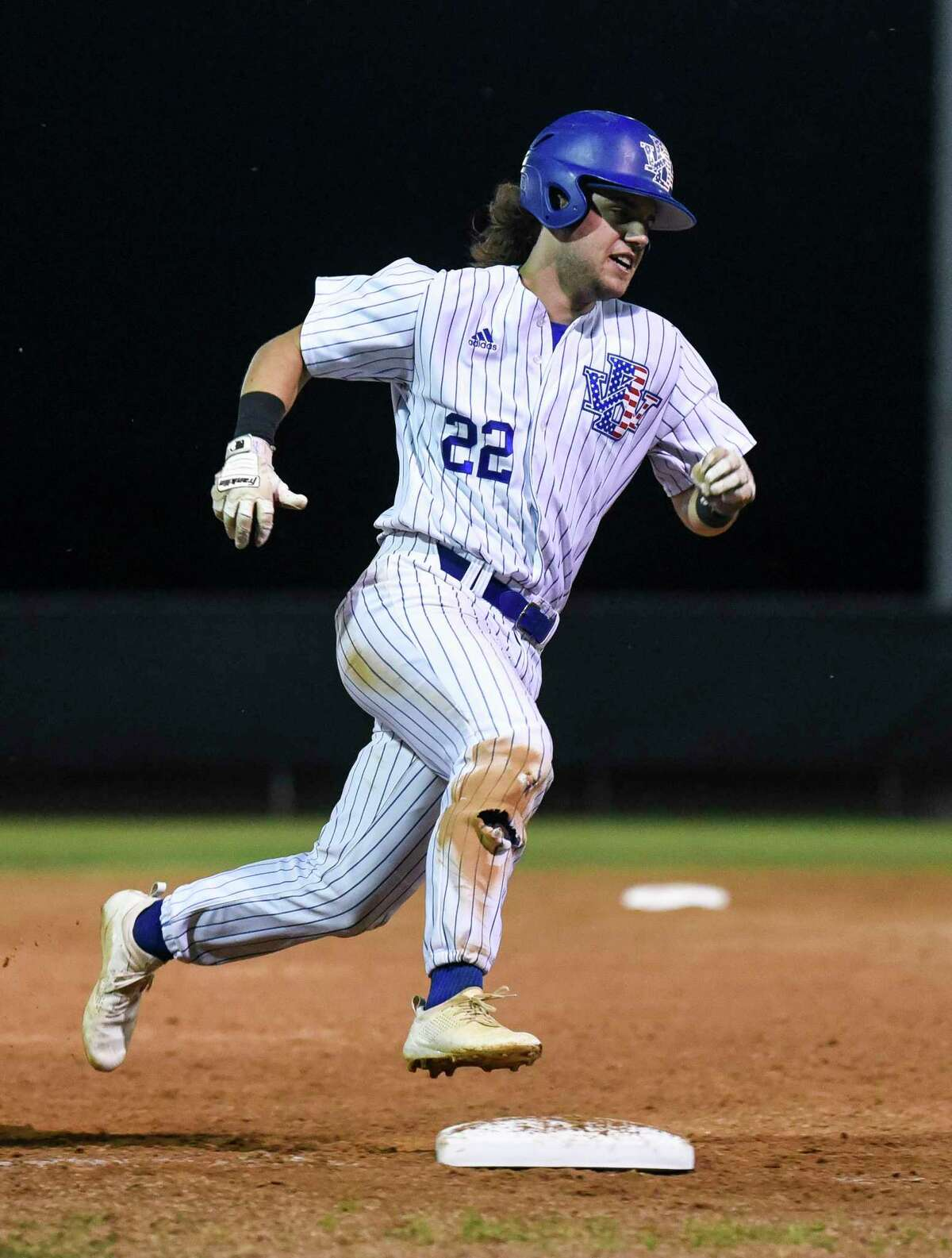 West Brook's Cal Fulton runs pass third base heading home during the game against North Shore at West Brook High School Tuesday night. Photo taken on Tuesday, 04/09/19. Ryan Welch/The Enterprise