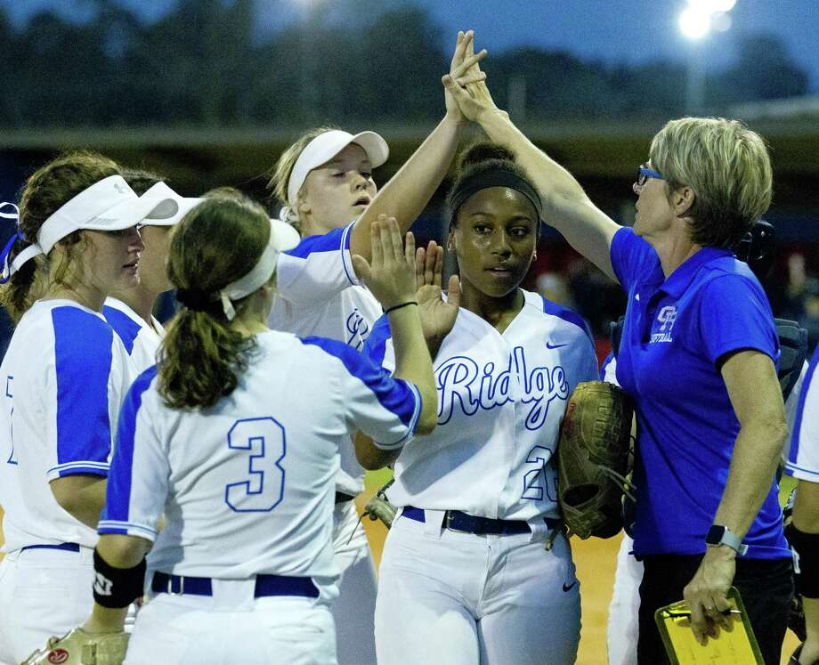 In this file photo, Oak Ridge starting pitcher Morgan Brandon (26) gets a high-five from Sam Graeter during the second inning of a District 15-6A high school softball at Oak Ridge High School, Friday, March 8, 2019, in Oak Ridge. Photo: Jason Fochtman, Houston Chronicle / Staff Photographer / © 2019 Houston Chronicle